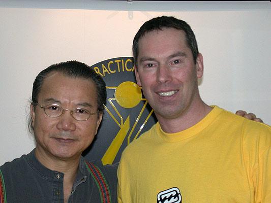 Grandaster Wan Kam Leung and James Sinclair.