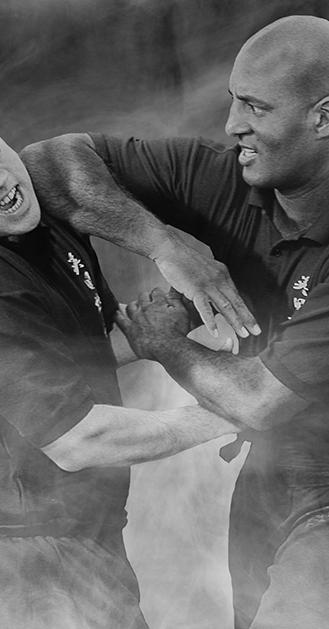 Wing Chun Master Mark Phillips penetrates his partners guard in Chi Sau.