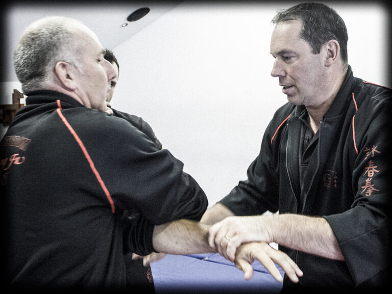 James Sinclair uses the Taan Sau to transition to Laap Sau an cross partner arms. A common Wing Chun Chi Sau technique.