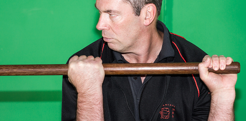 James Sinclair is seen demonstrating the Wing Chun Pole grips. The distance is between the hands is no wider than the shoulders.