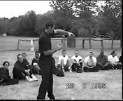 At the 19915 Wing Chu Summer Camp James Sinclair demonstrates short range punch to break 5 handheld tiles