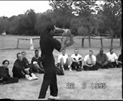 At the 19915 Wing Chun Summer Camp James Sinclair demonstrates short range punch to break 5 handheld tiles