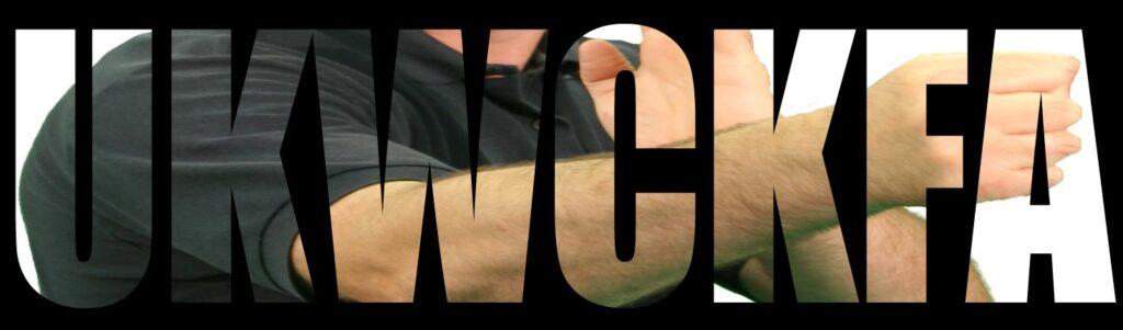 Wing Chun Kung Fu turning punch shown through UKWCKFA letters