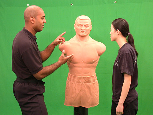 Wing Chun teaching using the 'Bob' dummy.  Are Mark Phillips is discussing pressure lints.