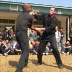 James Sinclair teaching in Hong Kong to a large outdoor audience at the 2nd World VTAA Conference. He was assisted by Master Mark Phillips of the London Wing Chun Academy. 2005. James was teaching ideas when you cant retreat.