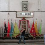 James Sinclair poses Bon Sau in the Ching Woo school Foshan, China 2005