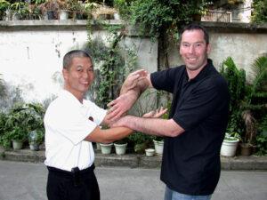 2005 Foshan China. James Sinclair and Master Fung Man pose in Chi Sau.