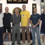 Grandmaster wan Kam Leung with James Sinclair and his students.