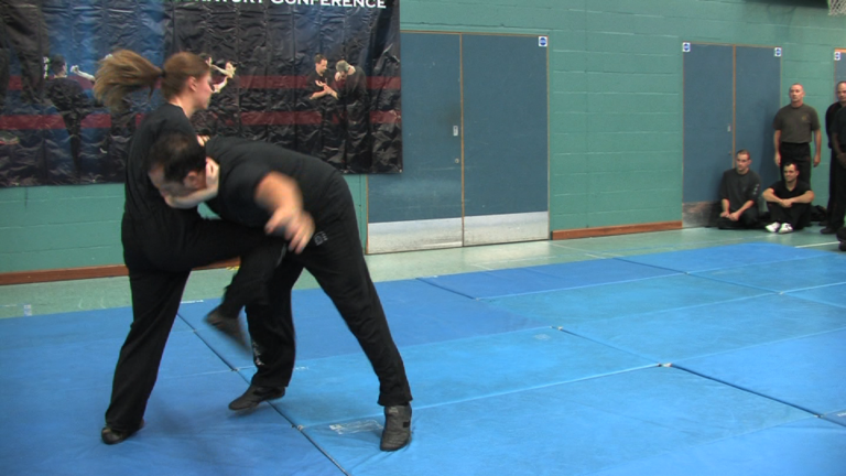 UK Wing Chun Assoc. 25th Anniversary. Poppy Young uses a knes strike to great effect.