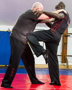 Master Eric Wilson uses a strike to the lower abdomen bladder.