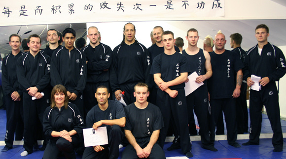 Siu Nim Tao syllabus grading at National HQ. These students worked very hard to achieve their scores.